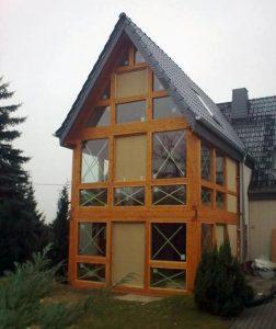 Hausanbau im Fachwerkstil mit Verglasung, Holzbau-Steinbach GmbH